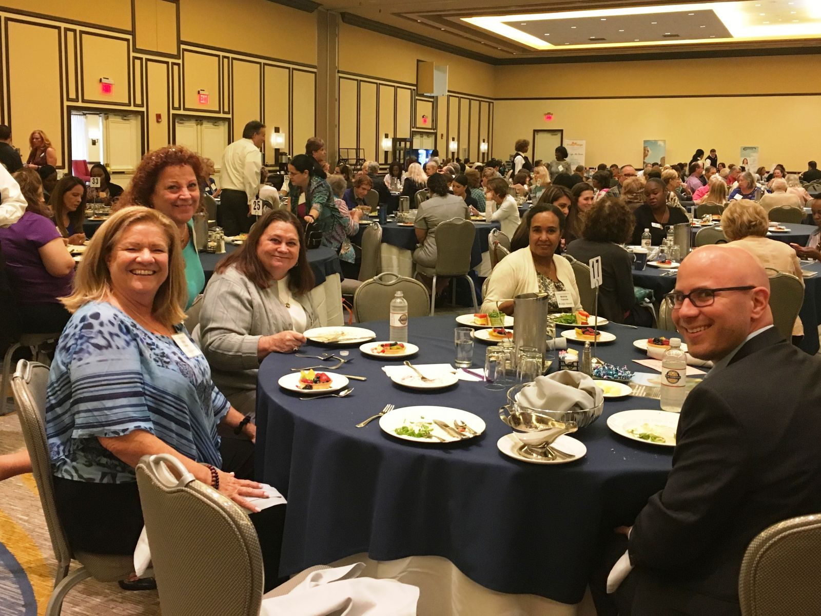 Attorney Jonathan Karp (right) mingles with attendees at the luncheon