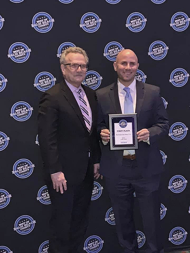 Attorney Joseph Karp and Attorney Jonathan Karp accept the Best Law Firm in Palm Beach County award