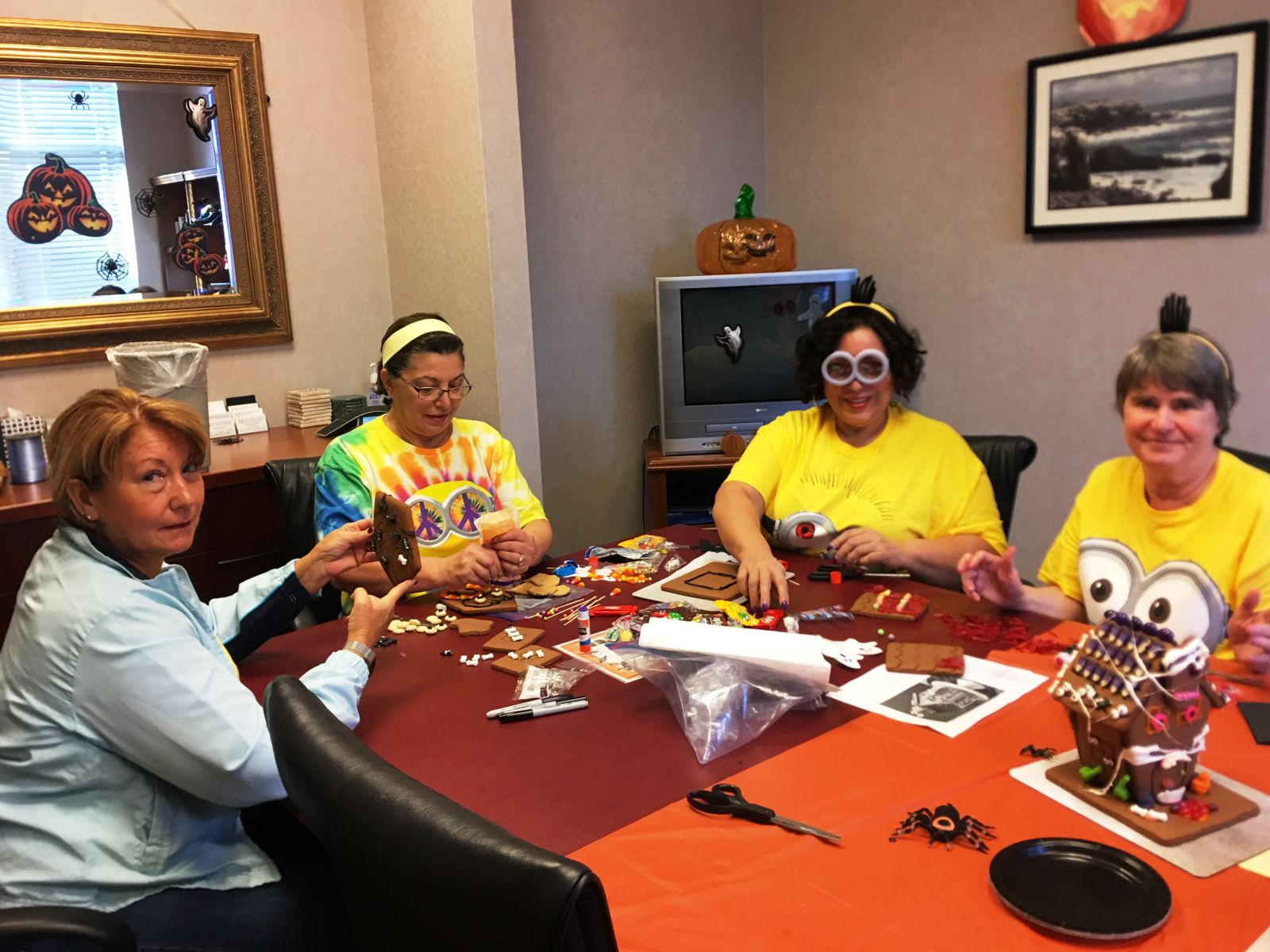 The Estate Administration Department at work on their haunted house. (L-R) Paralegals Janet Suarez, Ana Stalker, Norma Cruz and Gail Brown